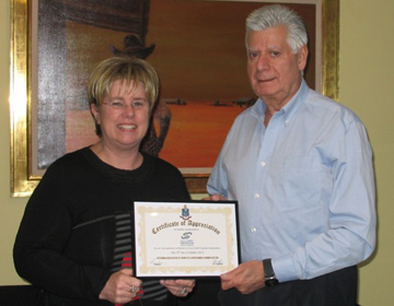 Judy Landau presents Jack Morgan with Certificate of Appreciation from VAJEX